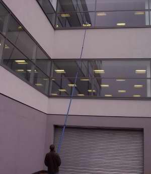Our ladderless window cleaning system in action